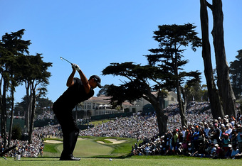SAN FRANCISCO, CA - JUNE 15:  Tiger Woods of the United States hits his tee shot on the eighth hole during the second round of the 112th U.S. Open at The Olympic Club on June 15, 2012 in San Francisco, California.  (Photo by Stuart Franklin/Getty Images)
