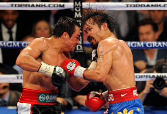 LAS VEGAS, NV - NOVEMBER 12:  Juan Manuel Marquez (L) and Manny Pacquiao battle in the 10th round of their WBO world welterweight title fight at the MGM Grand Garden Arena November 12, 2011 in Las Vegas, Nevada. Pacquiao retained his title with a majority