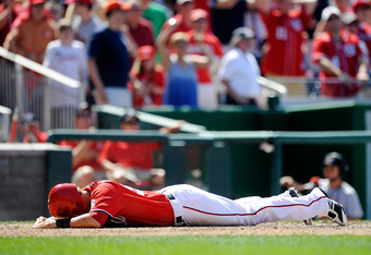 WASHINGTON, DC - JUNE 16:  Tyler Moore #57 of the Washington Nationals reacts after being thrown out at home plate during the eighth inning against the New York Yankees at Nationals Park on June 16, 2012 in Washington, DC.  (Photo by Patrick McDermott/Get