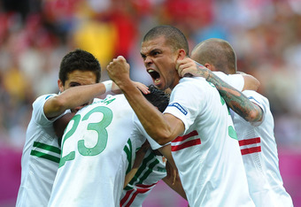 L'VIV, UKRAINE - JUNE 13:  Pepe celebrates after Helder Postiga of Portugal scored the second goal during the UEFA EURO 2012 group B match between Denmark and Portugal at Arena Lviv on June 13, 2012 in L'viv, Ukraine.  (Photo by Laurence Griffiths/Getty I