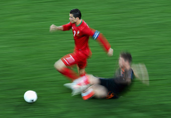 KHARKOV, UKRAINE - JUNE 17:  Cristiano Ronaldo of Portugal evades a challenge during the UEFA EURO 2012 group B match between Portugal and Netherlands at Metalist Stadium on June 17, 2012 in Kharkov, Ukraine.  (Photo by Lars Baron/Getty Images)