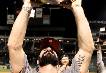 ARLINGTON, TX - NOVEMBER 01:  Brian Wilson #38 of the San Francisco Giants celebrates with the World Series Championship trophy after the Giants won 3-1 the Texas Rangers in Game Five of the 2010 MLB World Series at Rangers Ballpark in Arlington on Novemb