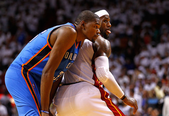 MIAMI, FL - JUNE 17:  (L-R) Kevin Durant #35 and LeBron James #6 of the Miami Heat look on in the seocnd half of Game Three of the 2012 NBA Finals on June 17, 2012 at American Airlines Arena in Miami, Florida.  NOTE TO USER: User expressly acknowledges an