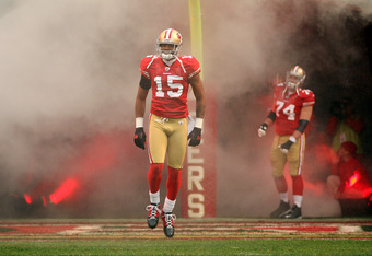 SAN FRANCISCO, CA - JANUARY 22:  Michael Crabtree #15 of the San Francisco 49ers runs onto the field during player introductions against the New York Giants during the NFC Championship Game at Candlestick Park on January 22, 2012 in San Francisco, Califor