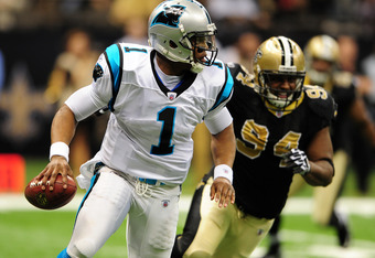 NEW ORLEANS, LA - JANUARY 1: Cam Newton #1 of the Carolina Panthers scrambles against Cameron Jordan #94 of the New Orleans Saints at the Mercedes-Benz Superdome on January 1, 2012 in New Orleans, Louisiana  (Photo by Scott Cunningham/Getty Images)
