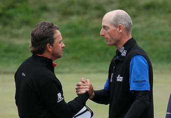 SAN FRANCISCO, CA - JUNE 17:  Graeme McDowell of Northern Ireland (L) and Jim Furyk of the United States (R) shake hands on the 18th green during the final round of the 112th U.S. Open at The Olympic Club on June 17, 2012 in San Francisco, California.  (P