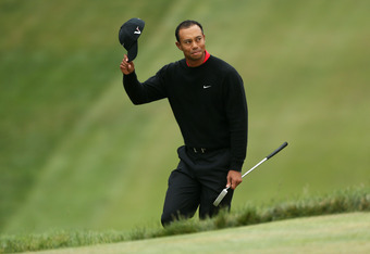 SAN FRANCISCO, CA - JUNE 17:  Tiger Woods of the United States waves to the gallery on the 18th green during the final round of the 112th U.S. Open at The Olympic Club on June 17, 2012 in San Francisco, California.  (Photo by Andrew Redington/Getty Images