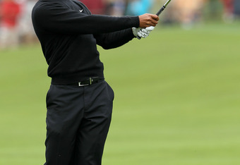 SAN FRANCISCO, CA - JUNE 17:  Tiger Woods of the United States plays a shot on the first hole during the final round of the 112th U.S. Open at The Olympic Club on June 17, 2012 in San Francisco, California.  (Photo by Jeff Gross/Getty Images)