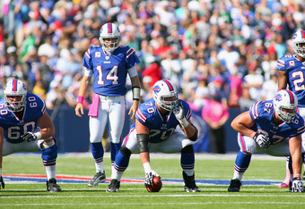 ORCHARD PARK, NY - OCTOBER 09:Ryan Fitzpatrick #14 of the Buffalo Bills linens up behind Kraig Urbik #60,Eric Wood #70 and Andy Levitre #67  against the Philadelphia Eagles  at Ralph Wilson Stadium on October 9, 2011 in Orchard Park, New York. Buffalo woi