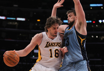 LOS ANGELES, CA - JANUARY 02:  Pau Gasol #16 of the Los Angeles Lakers is defended by Marc Gasol #33 of the Memphis Grizzlies during the second half at Staples Center on January 2, 2011 in Los Angeles, California. The Grizzlies defeated the Lakers 104-85.