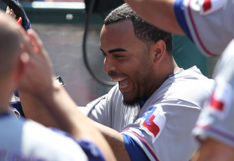 ANAHEIM, CA - JUNE 03:  Nelson Cruz #17 (R) of the Texas Rangers celebrates as he returns to the dugout after hitting a two run home run in the seventh inning against the Los Angeles Angels of Anaheim at Angel Stadium of Anaheim on June 3, 2012 in Anaheim