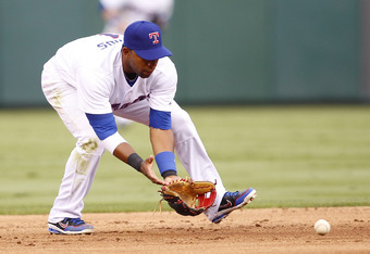 ARLINGTON, TX - JUNE 16: Elvis Andrus #1 of the Texas Rangers firlds a ground ball against the Houston Astros at Rangers Ballpark in Arlington on June 16, 2012 in Arlington, Texas. (Photo by Rick Yeatts/Getty Images)