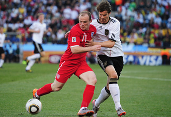 BLOEMFONTEIN, SOUTH AFRICA - JUNE 27:  Wayne Rooney of England is challenged by Arne Friedrich of Germany during the 2010 FIFA World Cup South Africa Round of Sixteen match between Germany and England at Free State Stadium on June 27, 2010 in Bloemfontein