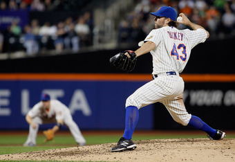NEW YORK, NY - JUNE 18:  R.A. Dickey #43 of the New York Mets delivers a pitch in the ninth-inning on his way to a complete game one hitter against the Baltimore Orioles at CitiField on June 18, 2012 in the Flushing neighborhood of the Queens borough of N