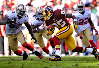 LANDOVER, MD - NOVEMBER 6: Wide receiver Leonard Hankerson #85 of the Washington Redskins eludes linebacker NaVorro Bowman #53, Dashon Goldson #38, and Carlos Rogers #22 of the San Francisco 49ers in the third quarter at FedExField on November 6, 2011 in