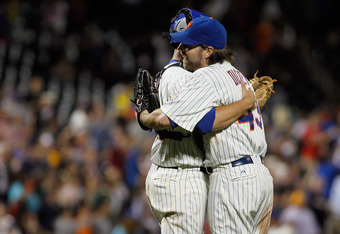 NEW YORK, NY - JUNE 18:  R.A. Dickey #43 of the New York Mets celebrates with teammate Josh Thole #30 after pitching a complete game one hitter against the Baltimore Orioles at CitiField on June 18, 2012 in the Flushing neighborhood of the Queens borough