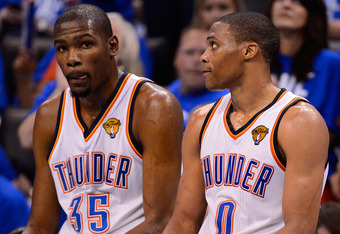 OKLAHOMA CITY, OK - JUNE 12:  Kevin Durant #35 and Russell Westbrook #0 of the Oklahoma City Thunder sits on the scorer's table in the fourth quarter while taking on the Miami Heat in Game One of the 2012 NBA Finals at Chesapeake Energy Arena on June 12,