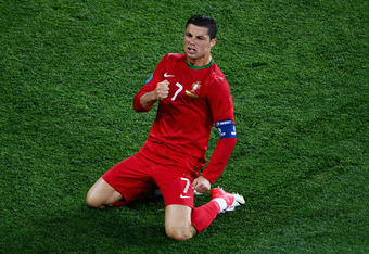 KHARKOV, UKRAINE - JUNE 17:  Cristiano Ronaldo of Portugal celebrates scoring his team's second goal during the UEFA EURO 2012 group B match between Portugal and Netherlands at Metalist Stadium on June 17, 2012 in Kharkov, Ukraine.  (Photo by Lars Baron/G