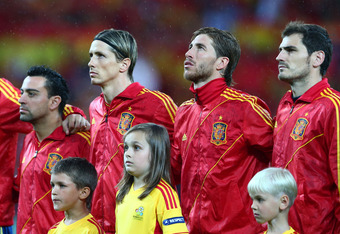 GDANSK, POLAND - JUNE 14:  Fernando Torres and  Sergio Ramos and Iker Casillas of Spain line up during the UEFA EURO 2012 group C match between Spain and Ireland at The Municipal Stadium on June 14, 2012 in Gdansk, Poland.  (Photo by Michael Steele/Getty