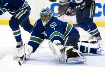 VANCOUVER, CANADA - APRIL 11: Goalie Roberto Luongo #1 of the Vancouver Canucks dives for the loose puck during the first period in Game One of the Western Conference Quarterfinals during the 2012 NHL Stanley Cup Playoffs at Rogers Arena on April 11, 2012