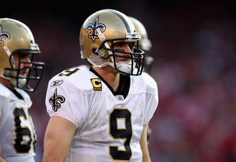 Drew Brees has been a no-show at OTAs and minicamp, but won't likely miss the 2012 season.