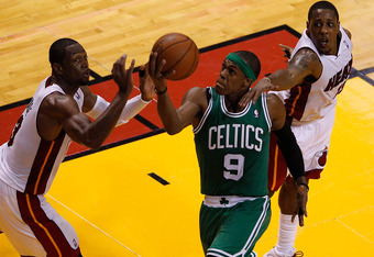 MIAMI, FL - JUNE 09:  Rajon Rondo #9 of the Boston Celtics goes up for a shot between Dwyane Wade #3 and Mario Chalmers #15 of the Miami Heat in the first half in Game Seven of the Eastern Conference Finals in the 2012 NBA Playoffs on June 9, 2012 at Amer