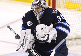 WINNIPEG, CANADA - MARCH 26: Ondrej Pavelec #31 of the Winnipeg Jets deflects a shot on goal during a game against the Ottawa Senators in NHL action at the MTS Centre on March 26, 2012 in Winnipeg, Manitoba, Canada. (Photo by Marianne Helm/Getty Images)