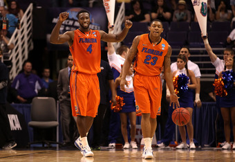 PHOENIX, AZ - MARCH 22:  Patric Young #4 and Bradley Beal #23 of the Florida Gators react while taking on the Marquette Golden Eagles during the 2012 NCAA Men's Basketball West Regional Semifinal game at US Airways Center on March 22, 2012 in Phoenix, Ari