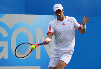 LONDON, ENGLAND - JUNE 13:  Andy Murray of Great Britain plays a forehand return during his mens singles second round match against Nicolas Mahut of France on day three of the AEGON Championships at Queens Club on June 13, 2012 in London, England.  (Photo