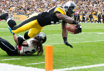 PITTSBURGH, PA - OCTOBER 16:  Rashard Mendenhall #34 of the Pittsburgh Steelers dives over the goal line to score a touchdown in the first quarter against the Jacksonville Jaguars during the game on October 16, 2011 at Heinz Field in Pittsburgh, Pennsylva