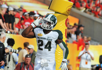 TMAPA, FL - JANUARY 02: Running back Le'Veon Bell #24 of the Michigan State Spartans celebrates after a touchdown run against the Georgia Bulldogs in the Outback Bowl January 2, 2012 at Raymond James Stadium, Tampa Florida. The Spartans won 33 - 30. (Phot