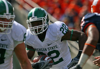 CHAMPAIGN, IL - OCTOBER 10: Larry Caper #22 of the Michigan State Spartans runs for a touchdown against the Illinois Fighting Illini on October 10, 2009 at Memorial Stadium at the University of Illinois in Champaign, Illinois. Michigan State defeated Illi