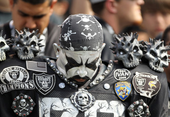 OAKLAND, CA - OCTOBER 16:  A fan bows his head during a moment of silence for Oakland Raiders owner Al Davis before the Raiders game against the Cleveland Browns at O.co Coliseum on October 16, 2011 in Oakland, California.  (Photo by Ezra Shaw/Getty Image