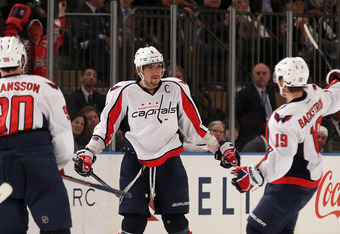 NEW YORK, NY - APRIL 30:  Alex Ovechkin #8 of the Washington Capitals celebrates with teammates Marcus Johansson #90 and Nicklas Backstrom #19 after Ovechkin scored a goal to give the Capitals a 3-2 lead in the third period in Game Two of the Eastern Conf