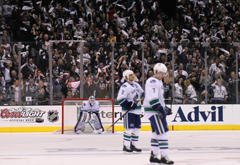 LOS ANGELES, CA - APRIL 15:  Goalie Cory Schneider#35, Kevin Bieksa #3, and David Booth #7 of the Vancouver Canucks react as fans cheer Dustin Brown's goal for the Los Angeles Kings in Game Three of the Western Conference Quarterfinals during the 2012 NHL