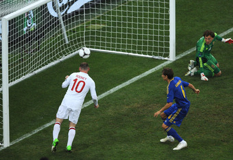 DONETSK, UKRAINE - JUNE 19:  Wayne Rooney of England scores their first goal during the UEFA EURO 2012 group D match between England and Ukraine at Donbass Arena on June 19, 2012 in Donetsk, Ukraine.  (Photo by Christopher Lee/Getty Images)