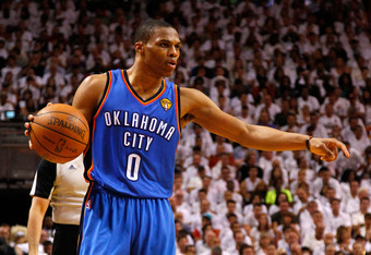 MIAMI, FL - JUNE 19:  Russell Westbrook #0 of the Oklahoma City Thunder directs the offense in the second half against the Miami Heat in Game Four of the 2012 NBA Finals on June 19, 2012 at American Airlines Arena in Miami, Florida. NOTE TO USER: User exp
