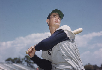 BOSTON - CIRCA 1955:  (UNDATED FILE PHOTO) Baseball legend Ted Williams (1918 - 2002) of the Boston Red Sox  swings a bat in this portrait circa 1955. The 83-year-old Williams, who was the last major league player to bat .400 when he hit .406 in 1941, die