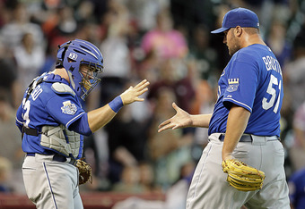 HOUSTON, TX - JUNE 20:  Catcher Humberto Quintero #33 of the Kansas City Royals shakes hands with pitcher Jonathan Broxton #51 of the Kansas City Royals after the final out against the Houston Astros at Minute Maid Park on June 20, 2012 in Houston, Texas.