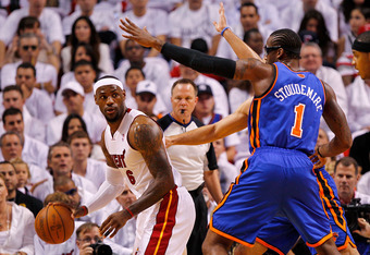 MIAMI, FL - APRIL 30:  LeBron James #6 of the Miami Heat posts up Amare Stoudemire #1 of the New York Knicks during Game Two of the Eastern Conference Quarterfinals in the 2012 NBA Playoffs  at American Airlines Arena on April 30, 2012 in Miami, Florida.