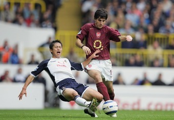 LONDON - OCTOBER 29:  Francesc Fabregas is tackled by Tottenham's Lee Young-Pyo during the Barclays Premiership match between Tottenham Hotspur and Arsenal at White Hart Lane on October 29, 2005 in London, England.  (Photo by Richard Heathcote/Getty Image
