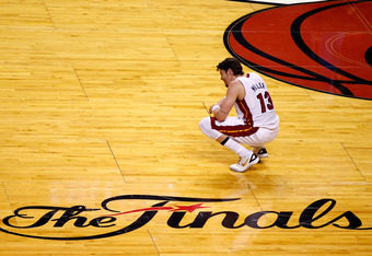 MIAMI, FL - JUNE 21:  Mike Miller #13 of the Miami Heat smiles as he crouches down on the court against the Oklahoma City Thunder in Game Five of the 2012 NBA Finals on June 21, 2012 at American Airlines Arena in Miami, Florida. NOTE TO USER: User express