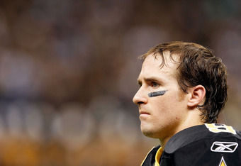 NEW ORLEANS, LA - JANUARY 07:   Drew Brees #9 of the New Orleans Saints looks on against the Detroit Lions during their 2012 NFC Wild Card Playoff game at Mercedes-Benz Superdome on January 7, 2012 in New Orleans, Louisiana.  (Photo by Kevin C. Cox/Getty
