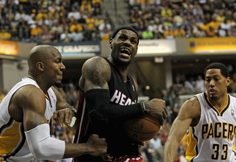INDIANAPOLIS, IN - MAY 20:  LeBron James #6 of the Miami Heat drives between David West #21 and Danny Granger #33 of the Indiana Pacers on his way to a game-high 40 points in Game Four of the Eastern Conference Semifinals in the 2012 NBA Playoffs at Banke