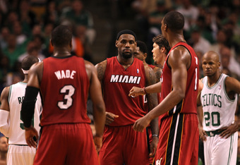 BOSTON, MA - JUNE 07:  (L-R) Dwyane Wade #3, LeBron James #6 and Chris Bosh #1 of the Miami Heat react against the Boston Celtics in Game Six of the Eastern Conference Finals in the 2012 NBA Playoffs on June 7, 2012 at TD Garden in Boston, Massachusetts.