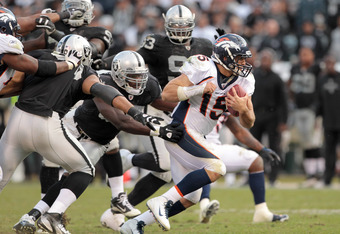 OAKLAND, CA - NOVEMBER 06:  Tim Tebow #15 of the Denver Broncos is surrounded by the Oakland Raiders defense at O.co Coliseum on November 6, 2011 in Oakland, California.  (Photo by Ezra Shaw/Getty Images)
