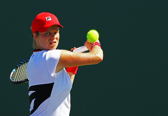 KEY BISCAYNE, FL - MARCH 24:  Kim Clijsters of Belguim in action against Yanina Wickmayer of Belguim during Day 6  at Crandon Park Tennis Center at the Sony Ericsson Open on March 24, 2012 in Key Biscayne, Florida.  (Photo by Al Bello/Getty Images)