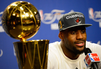 MIAMI, FL - JUNE 21:  LeBron James #6 of the Miami Heat answers questions from the media next to the Larry O'Brien Finals Championship trophy during his post game press conference after they won 121-106 against the Oklahoma City Thunder in Game Five of th