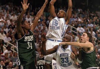 19 Mar 1998:  Guard Vince Carter of the North Carolina Tar Heels in action against forward Andre Hutson of the Michigan State Spartans during an NCAA Tournament game at the Greensboro Coliseum in Greensboro, North Carolina.  North Carolina defeated Michig