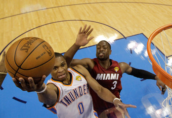OKLAHOMA CITY, OK - JUNE 12:  Russell Westbrook #0 of the Oklahoma City Thunder goes up for a layup in front of Dwyane Wade #3 of the Miami Heat in the first half in Game One of the 2012 NBA Finals at Chesapeake Energy Arena on June 12, 2012 in Oklahoma C